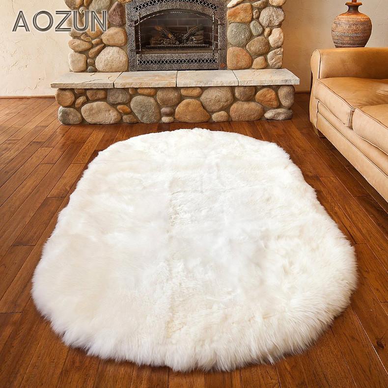 澳尊 米黄白色羊毛简约现代纯色椭圆形欧美手工织造 地毯