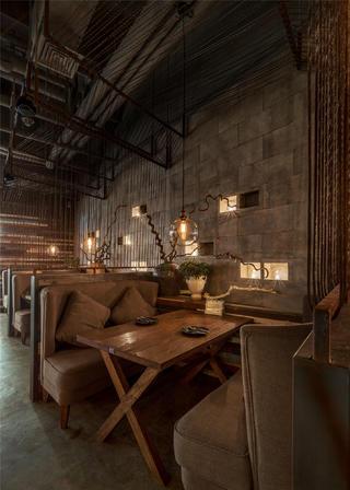 怀旧工业风餐厅装修钢丝绳隔断设计