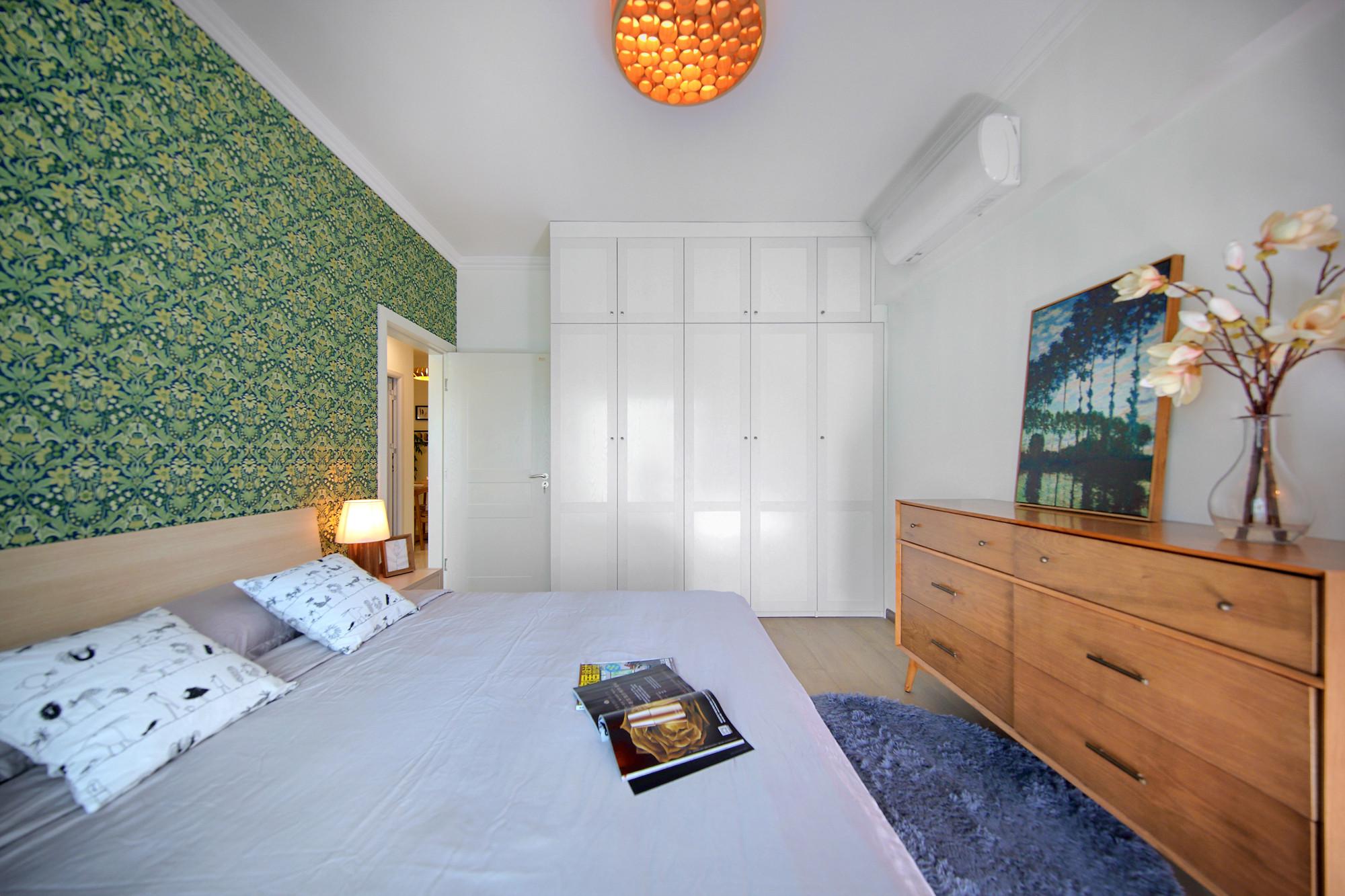 北欧三居装修到顶衣柜设计
