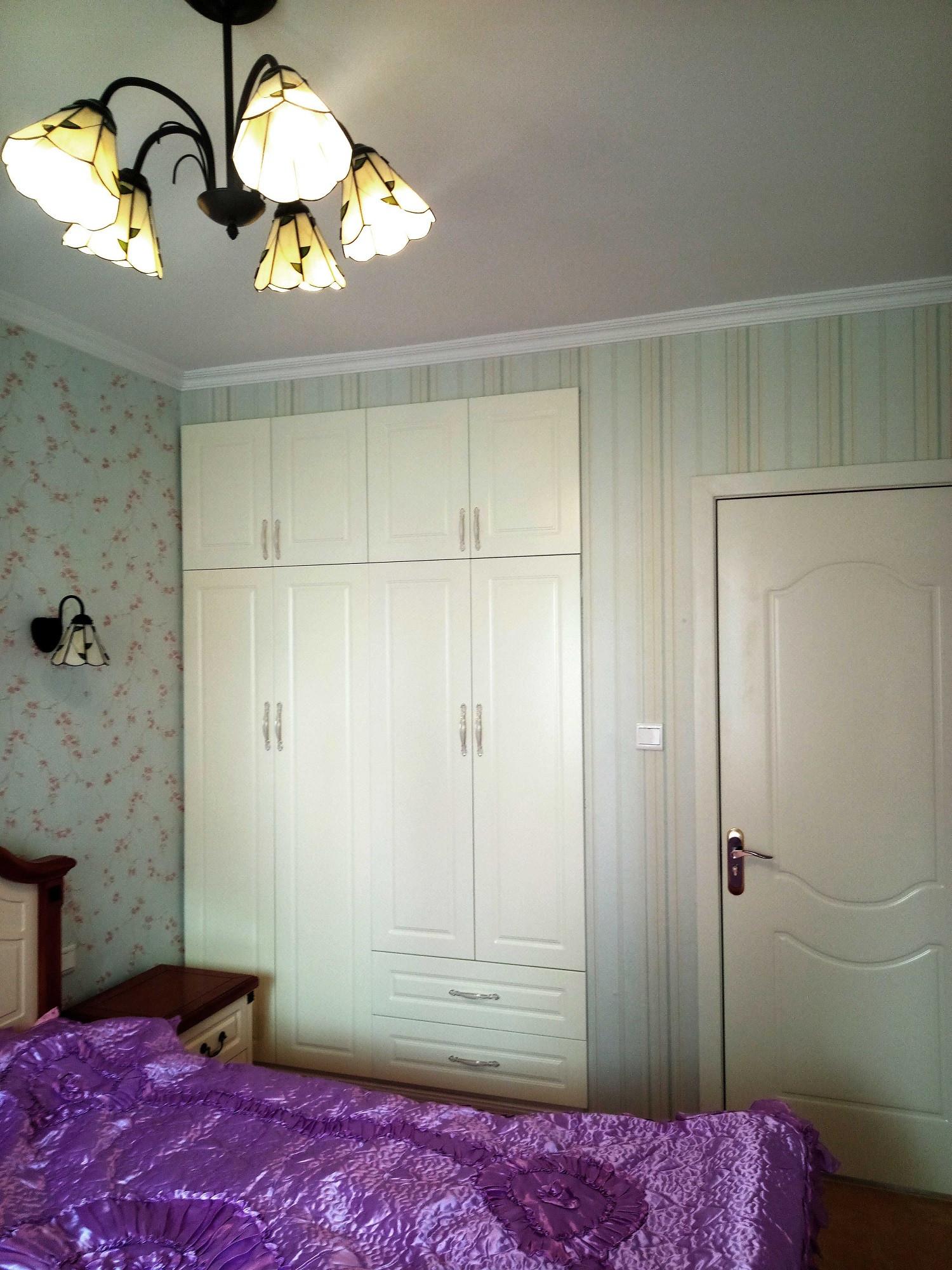 简约美式三居装修卧室设计图
