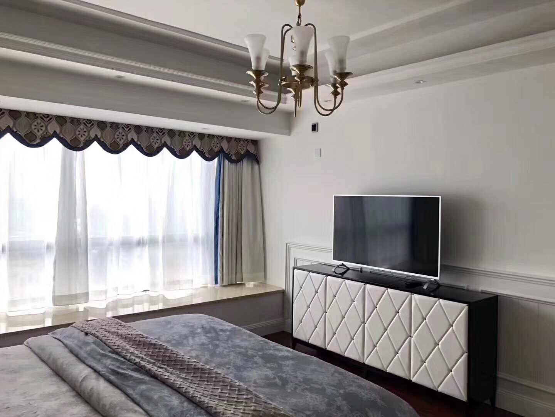 低调奢华简约风装修卧室电视柜图片