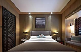 新中式四居装修卧室背景墙图片