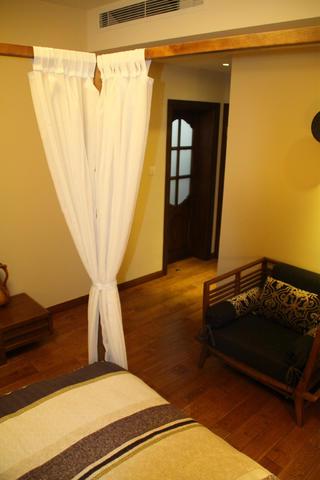 東南亞風格三居床幔圖片