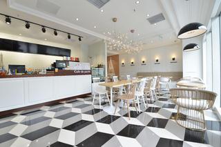 80平小清新咖啡厅装修拼图地面设计