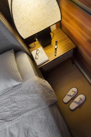 107平新中式三居装修床头一角