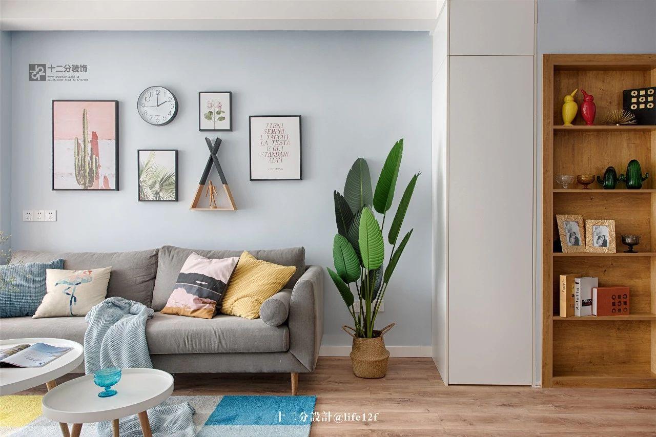 65平北欧风格沙发背景墙装修效果图