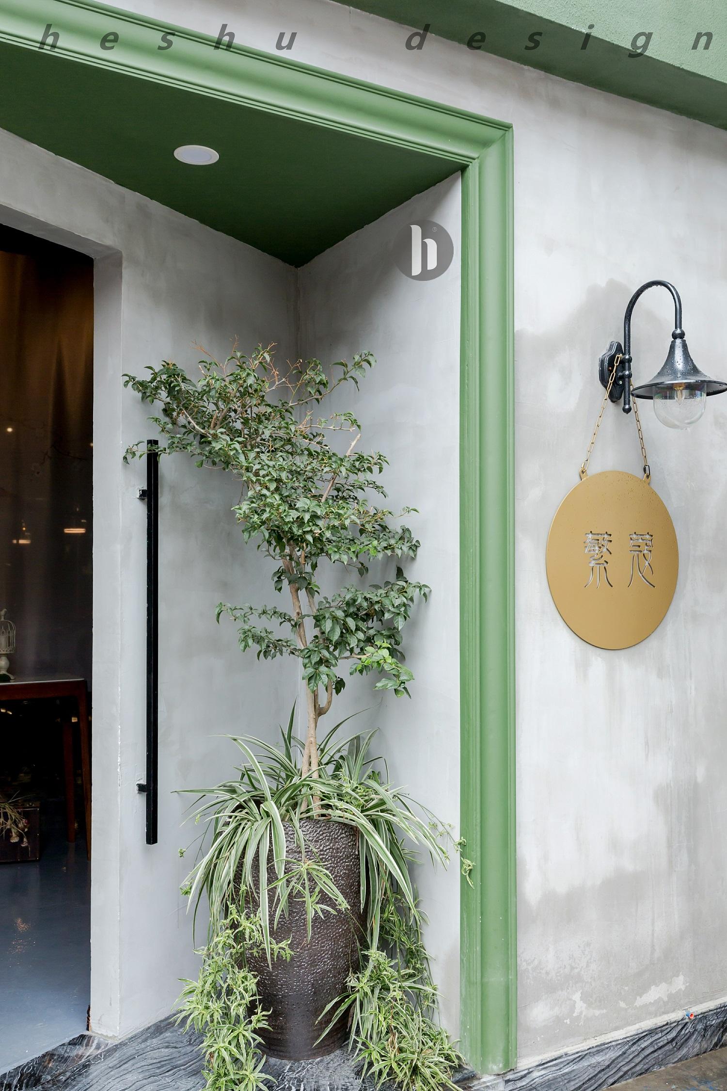 咖啡店装修效果图入口玄关绿植图片