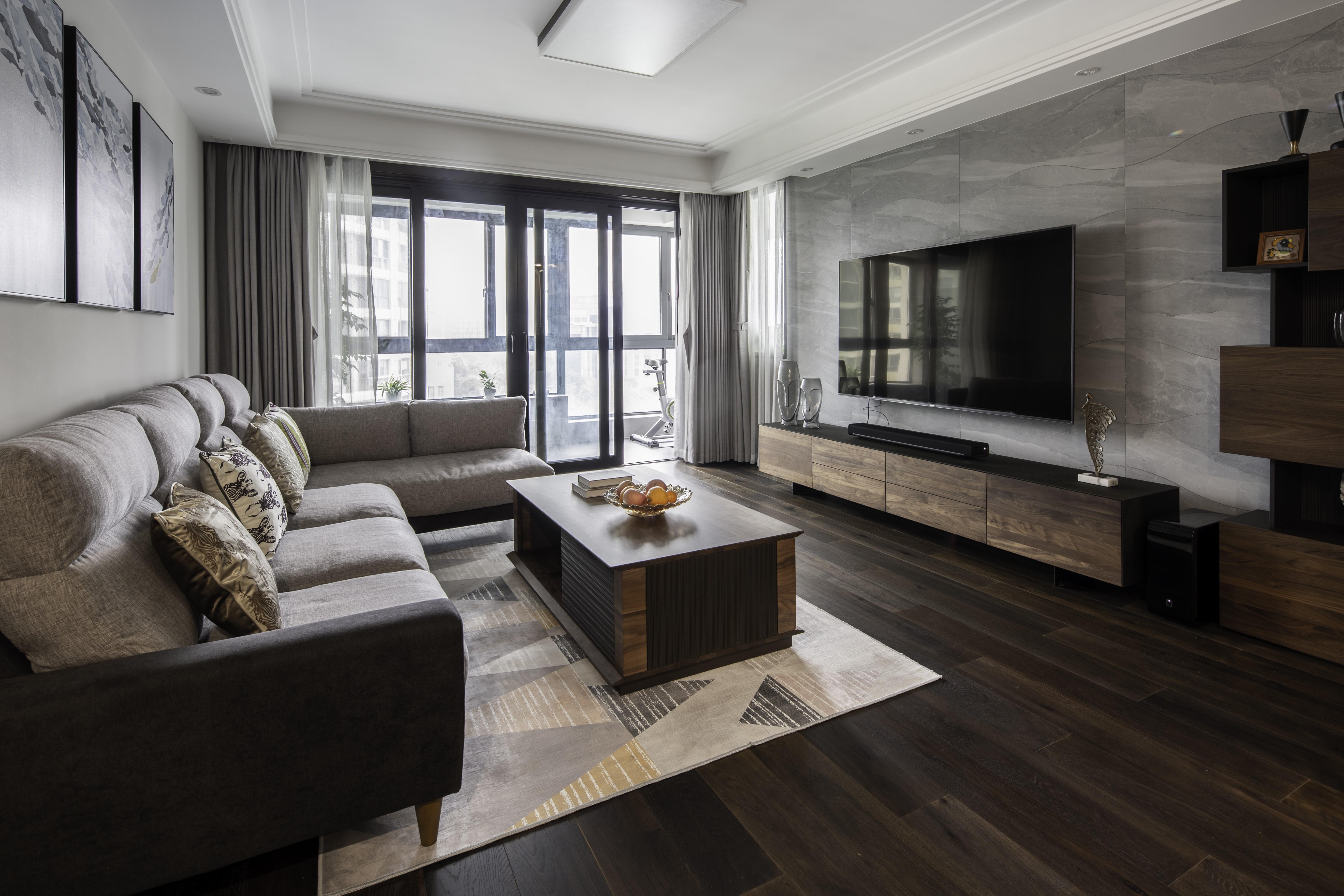 现代风三居客厅电视背景墙装修效果图