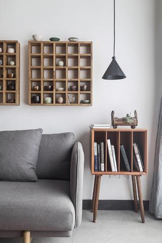 120平混搭风格装修沙发书柜边几设计