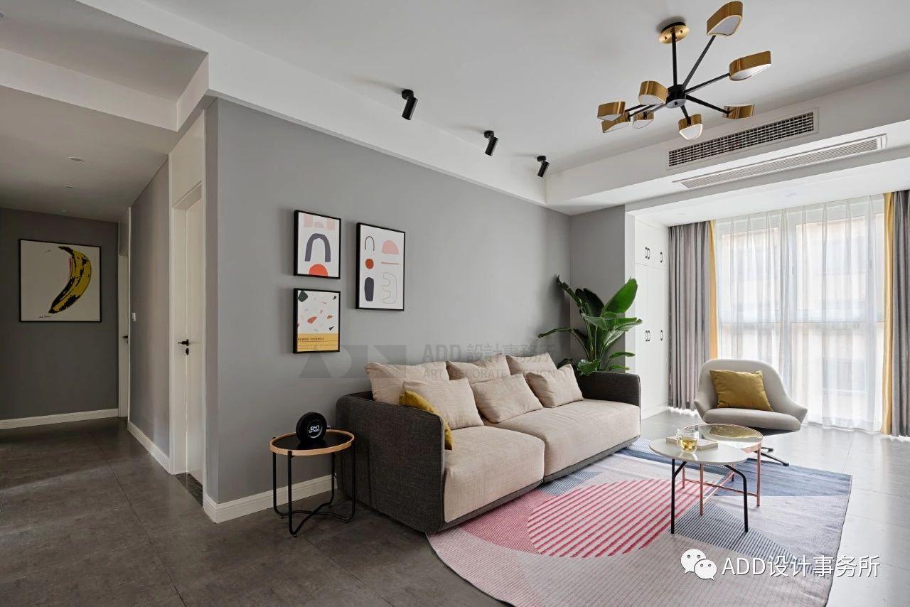 现代北欧风三居沙发背景墙装修效果图